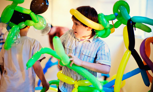 Boys Twisting Balloons